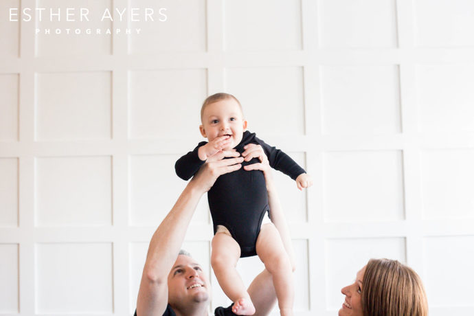 Six Month Old Boy lifted up in the air by Dad - Esther Ayers Photography